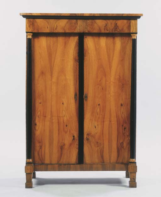 A South German Biedermeier walnut and ebonised cupboard