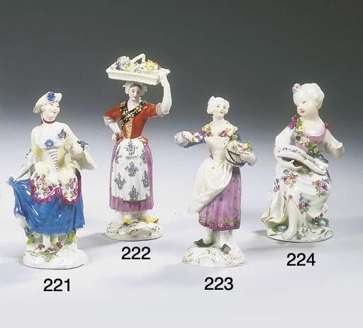 A Meissen porcelain figure of a female fruit hawker