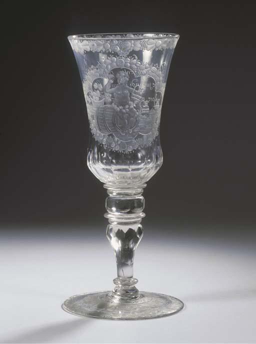 A Bohemian engraved faceted monogrammed Bacchus goblet