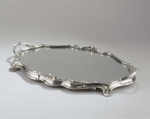 A plated table mirror