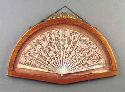 A mother of pearl and lace fan