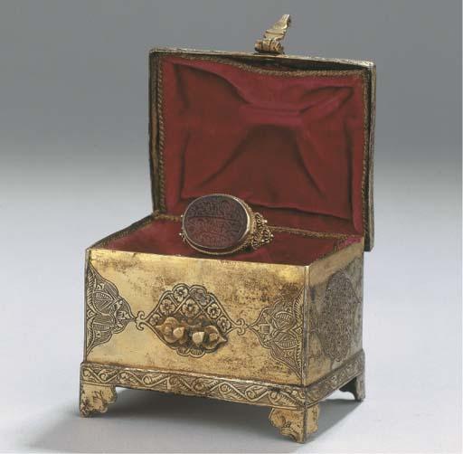 An oriental silver-gilt casket
