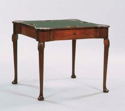 A German mahogany games table