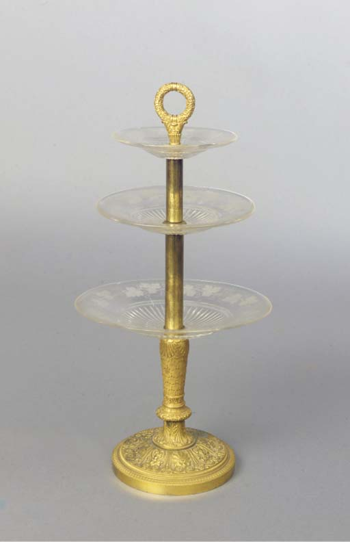 An ormolu and glass etagere