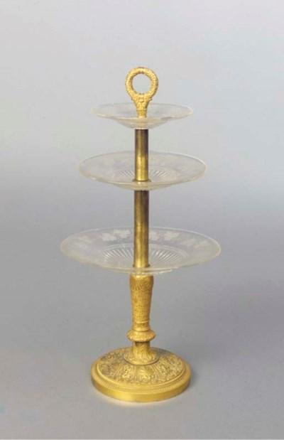 An ormolu and glass etagere