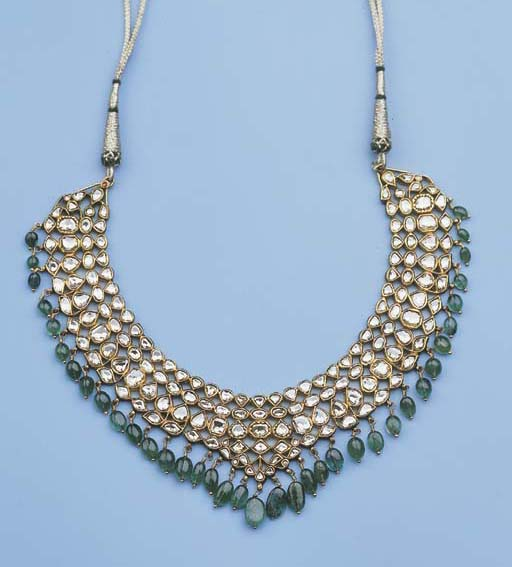 an indian gold necklace set wi