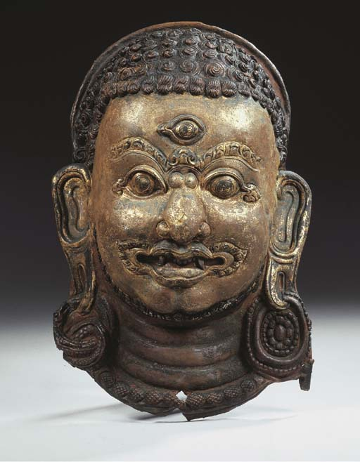 a nepalese repousse copper mas