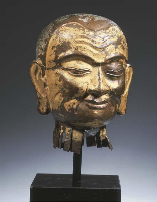 a tibetan repousee copper male