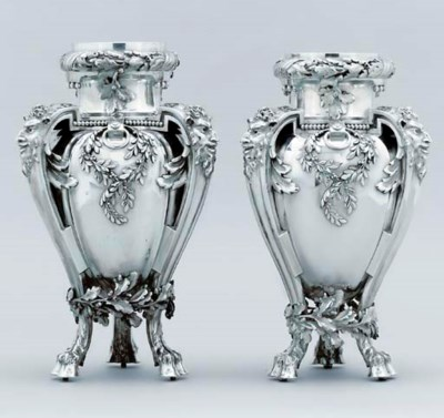A pair of French silver vases