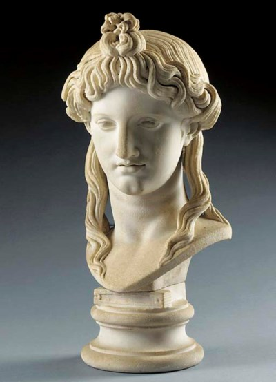 A CARVED MARBLE BUST OF APOLLO