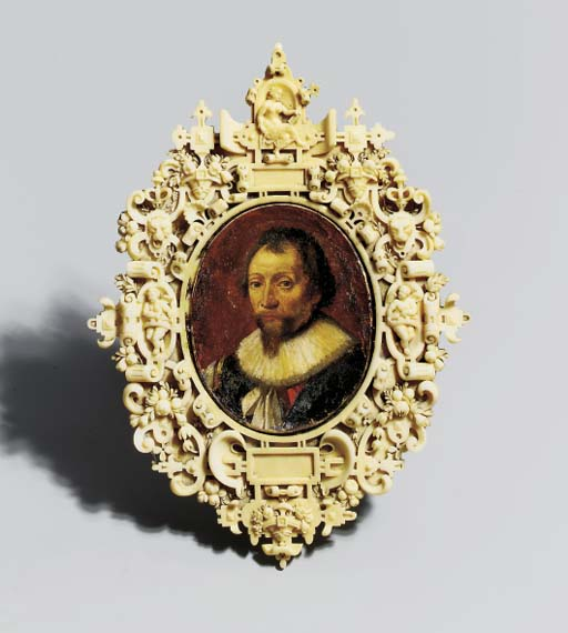 A CARVED IVORY FRAME WITH A PA