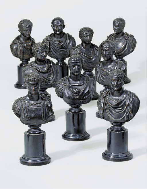 A SET OF NINE BRONZE BUSTS OF