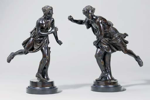 A PAIR OF BRONZE FIGURES OF AT