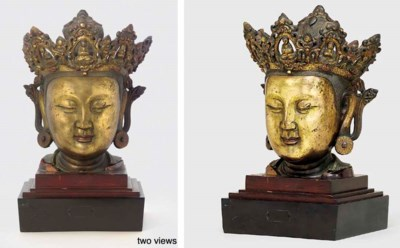 A GILT-BRONZE HEAD OF GUANYIN