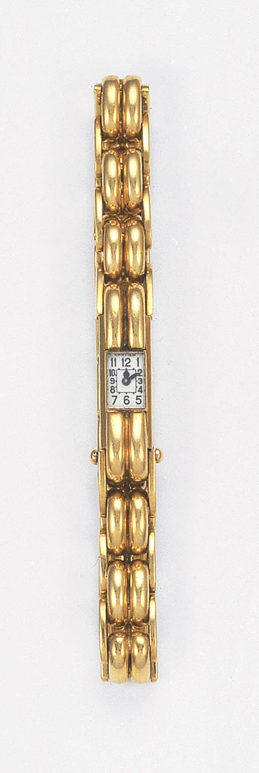 A LADY'S WRISTWATCH, BY CARTIE
