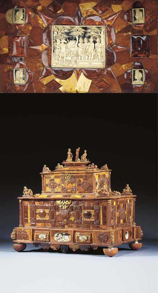 A CARVED AMBER AND IVORY TABLE