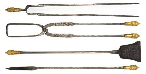 A SET OF FOUR LOUIS XVI-STYLE ORMOLU AND STEEL FIREIRONS