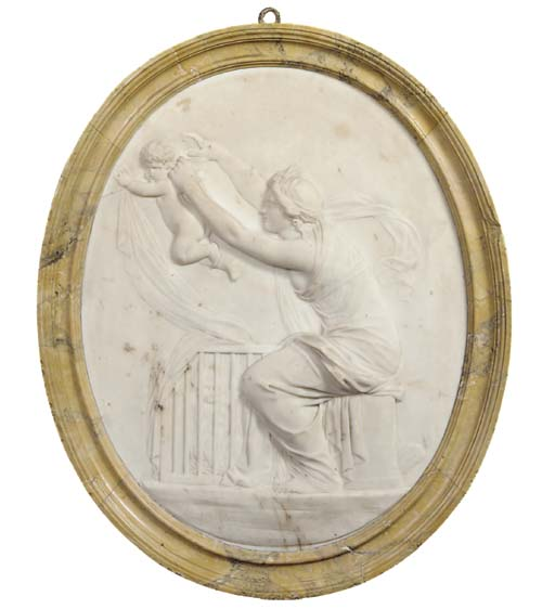 A CARVED MARBLE OVAL RELIEF OF A NYMPH AND PUTTI