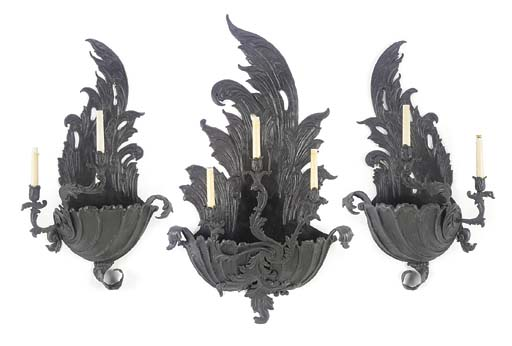 A SET OF THREE FRENCH BLACK-PAINTED REPOUSSE TOLE WALL-LIGHTS