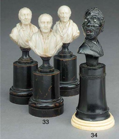 A SET OF THREE IVORY BUSTS OF