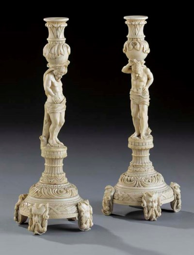 A large pair of ivory candlest