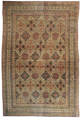 A MASSIVE KIRMAN CARPET