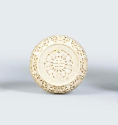 A SMALL CARVED IVORY BOX AND C
