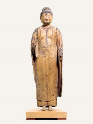 AN EARLY STANDING FIGURE OF AM