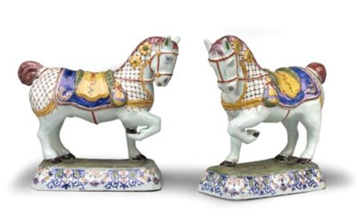 A PAIR OF DUTCH DELFT CAPARISO