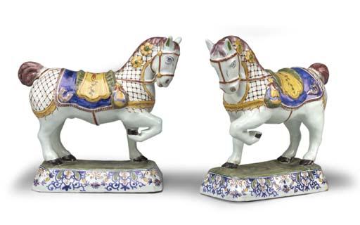 A PAIR OF DUTCH DELFT CAPARISONED HORSES
