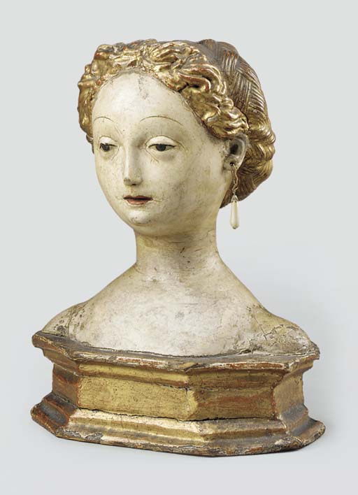 A PARCEL-GILT POLYCHROME CARVE
