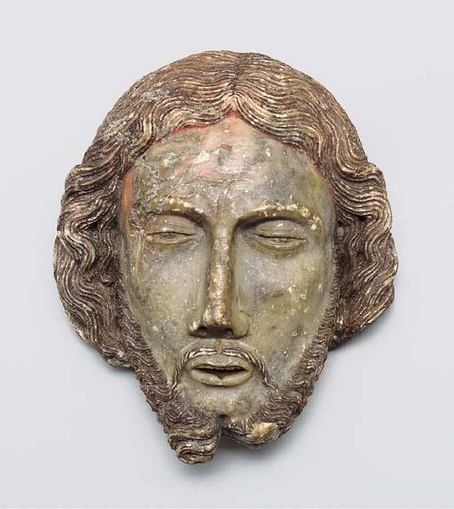 A CARVED ALABASTER HEAD OF ST.