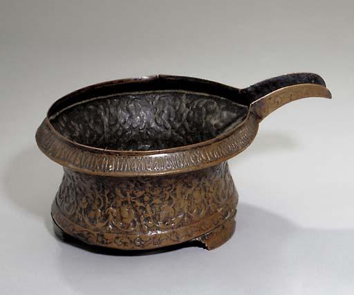A large copper bowl