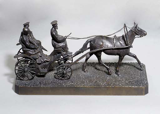 A bronze figure of a carriage