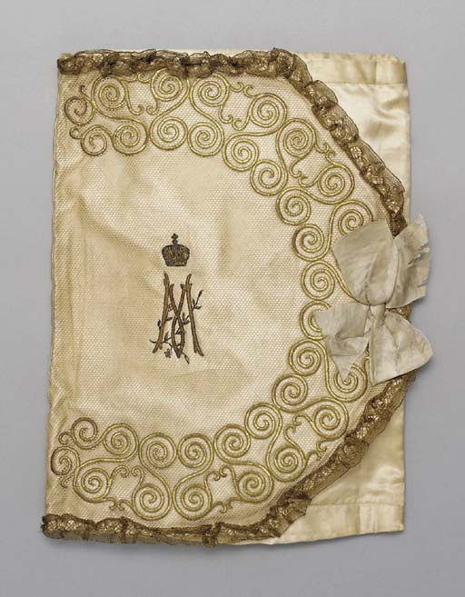 An Imperial silk pouch and dam