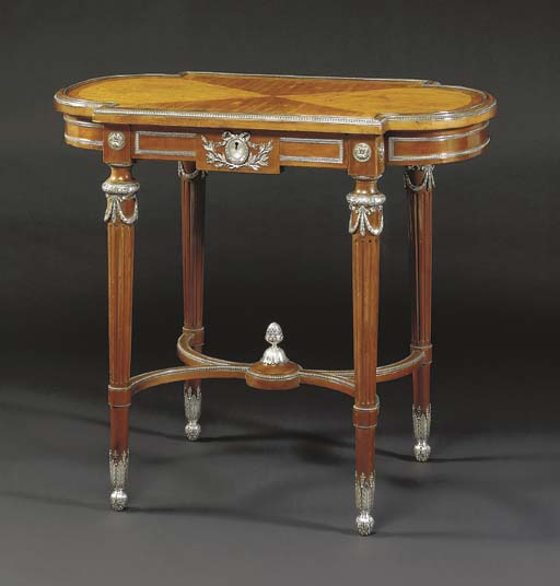 A silver-mounted wood table