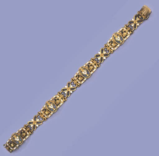 AN ANTIQUE GOLD AND ENAMEL BRA