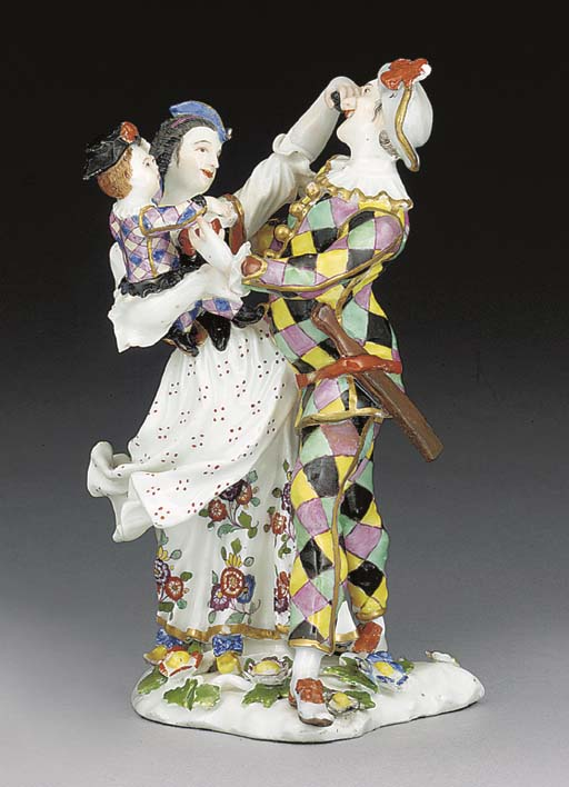A Meissen group of the Harlequ