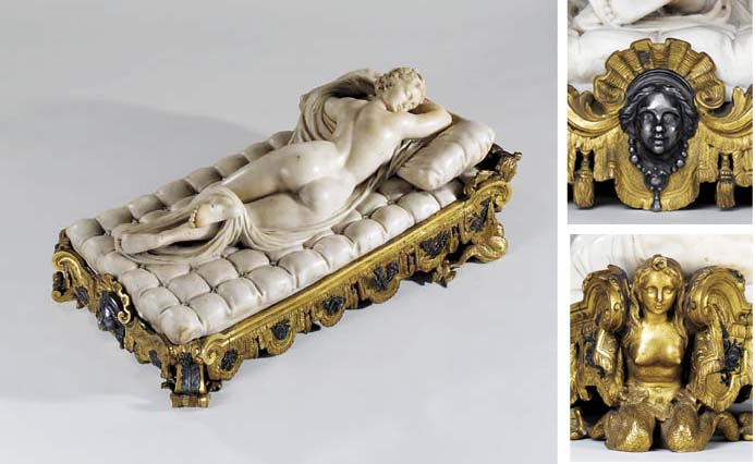 A CARVED MARBLE FIGURE OF THE