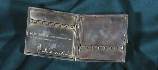 A silver cigarette-case given