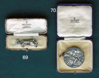 An Edwardian motorists brooch