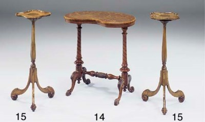 A pair of walnut candle stands