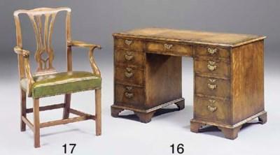 A walnut kneehole desk, circa