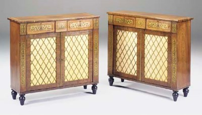 A pair of rosewood and brass i