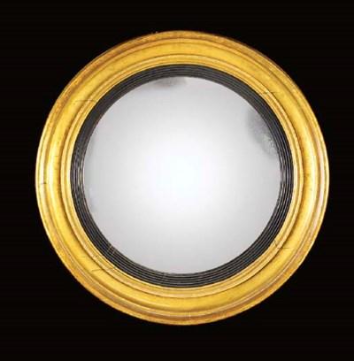 A giltwood convex mirror, earl