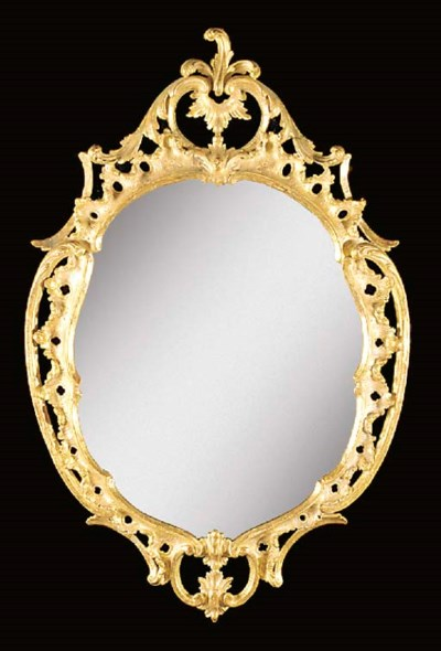 A giltwood oval wall mirror, 1