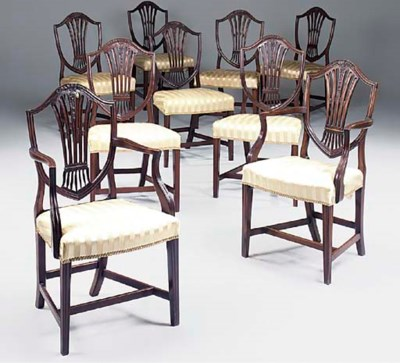A set of nine mahogany dining