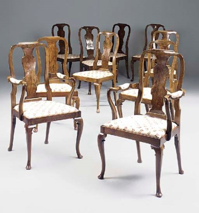 A set of ten walnut dining cha