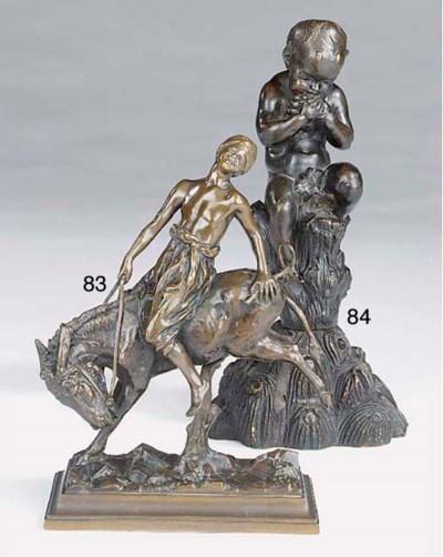 A German bronze group of a boy