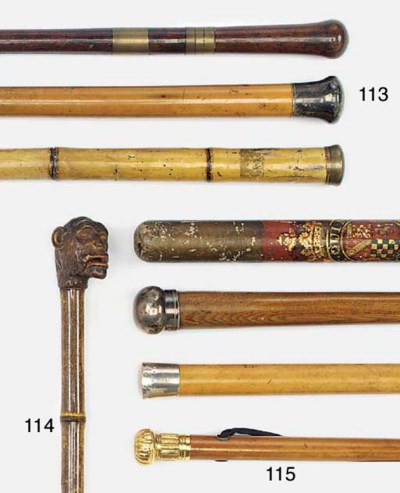 Three assorted walking canes,